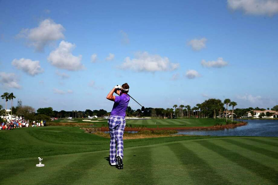 PALM BEACH GARDENS, FL - MARCH 01:  A general view of Ian Poulter of England playing his tee shot on the 18th hole during the continuation of the third round of The Honda Classic at PGA National Resort & Spa - Champion Course on March 1, 2015 in Palm Beach Gardens, Florida.  (Photo by Sam Greenwood/Getty Images) ORG XMIT: 527750903 Photo: Sam Greenwood / 2015 Getty Images