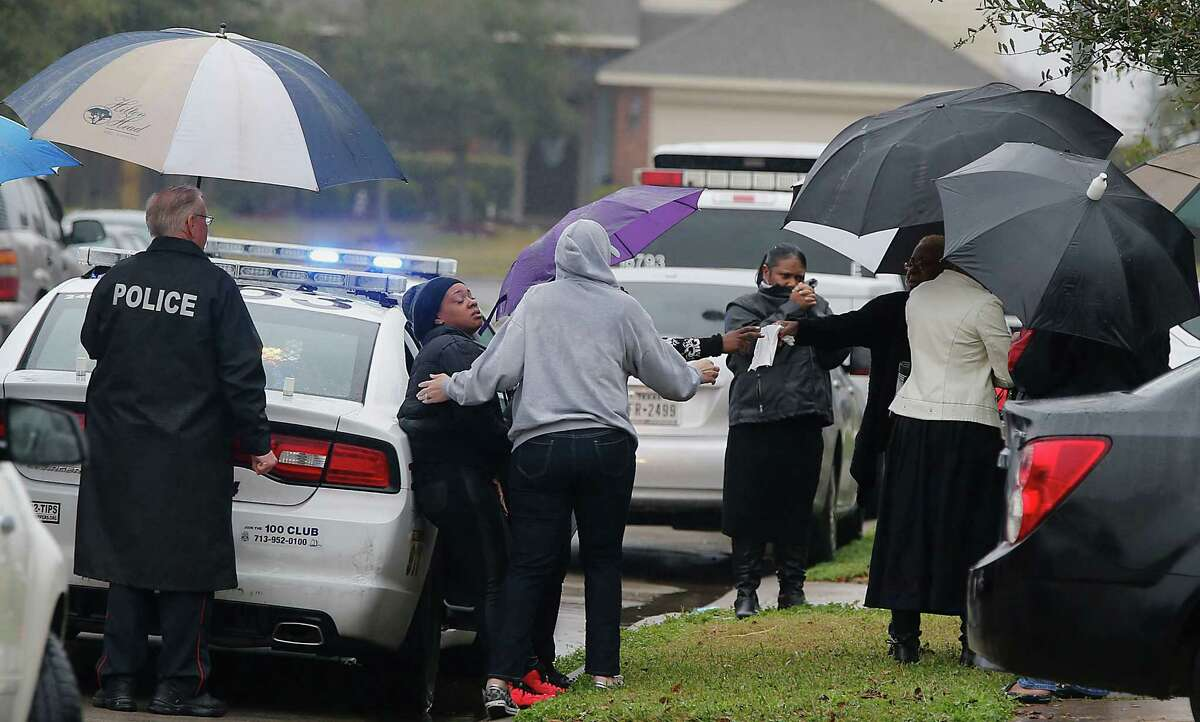 Friends comfort Ashley Beal, center left, the mother of a 4-year-old boy who died Sunday in an accidental shooting in the 19800 block of Imperial Stone, north of Greenspoint Mall.