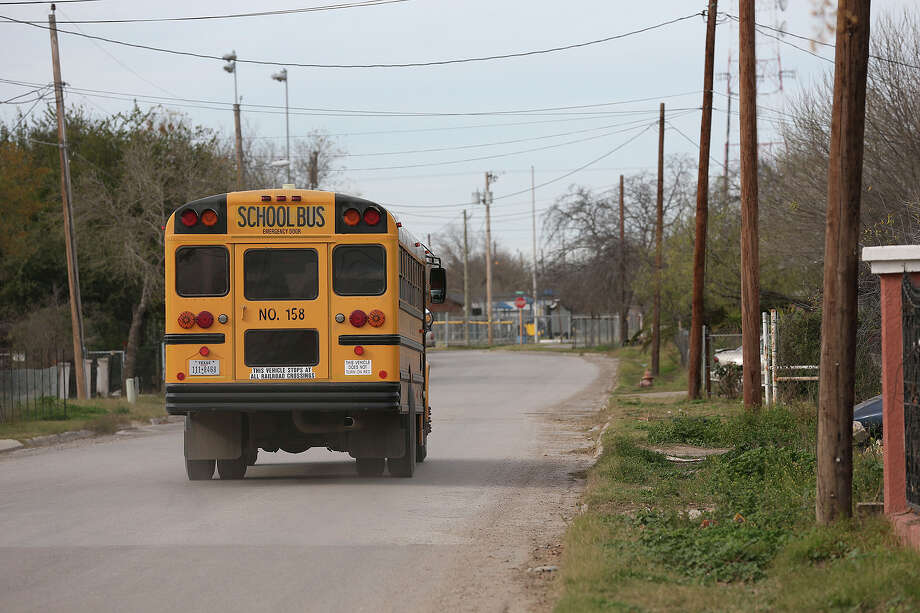 An Eagle Pass Independent School District bus drives children to their homes along in Maverick County. More than $70,000 was paid to a contractor to provide sidewalks along Lago Vista Drive, but the work was never done. An investigation ended with the indictments of officials and county employees, but a reader says corruption is so ingrained in the area that the indictments will not prevent future scandals. Photo: JERRY LARA /San Antonio Express-News / © 2015 San Antonio Express-News