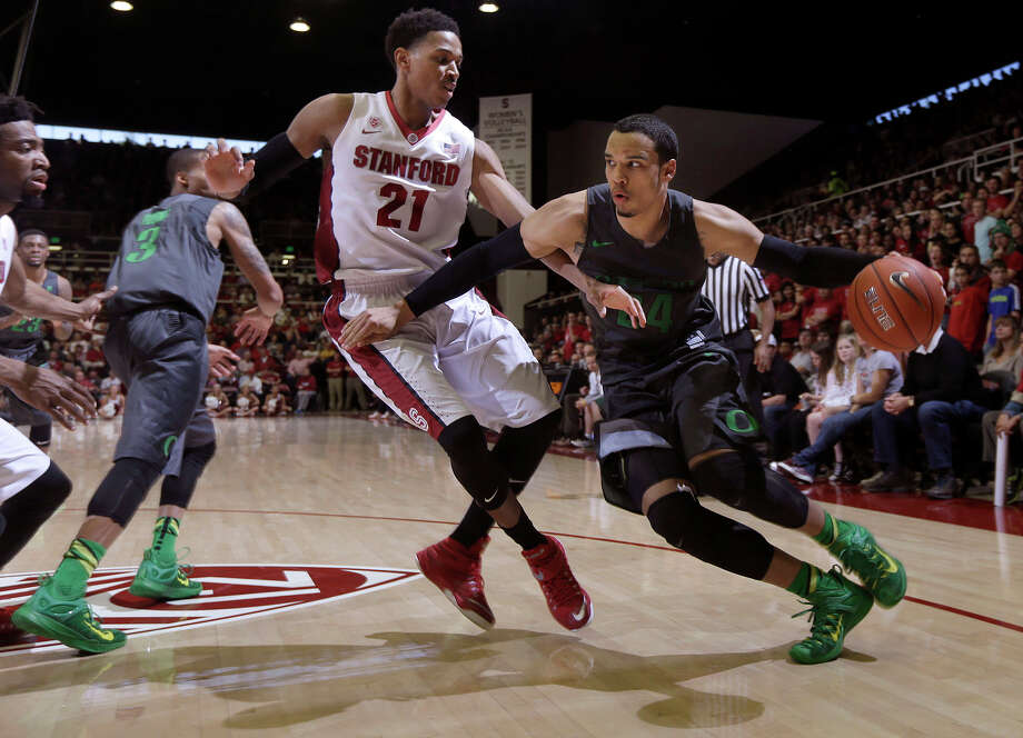 Oregon's Dillon Brooks dribbles against Stanford's Anthony Brown during the second half of their game at Maples Pavilion. Brown scored 11 points in his last regular-season home game. Photo: Jeff Chiu / Associated Press / AP