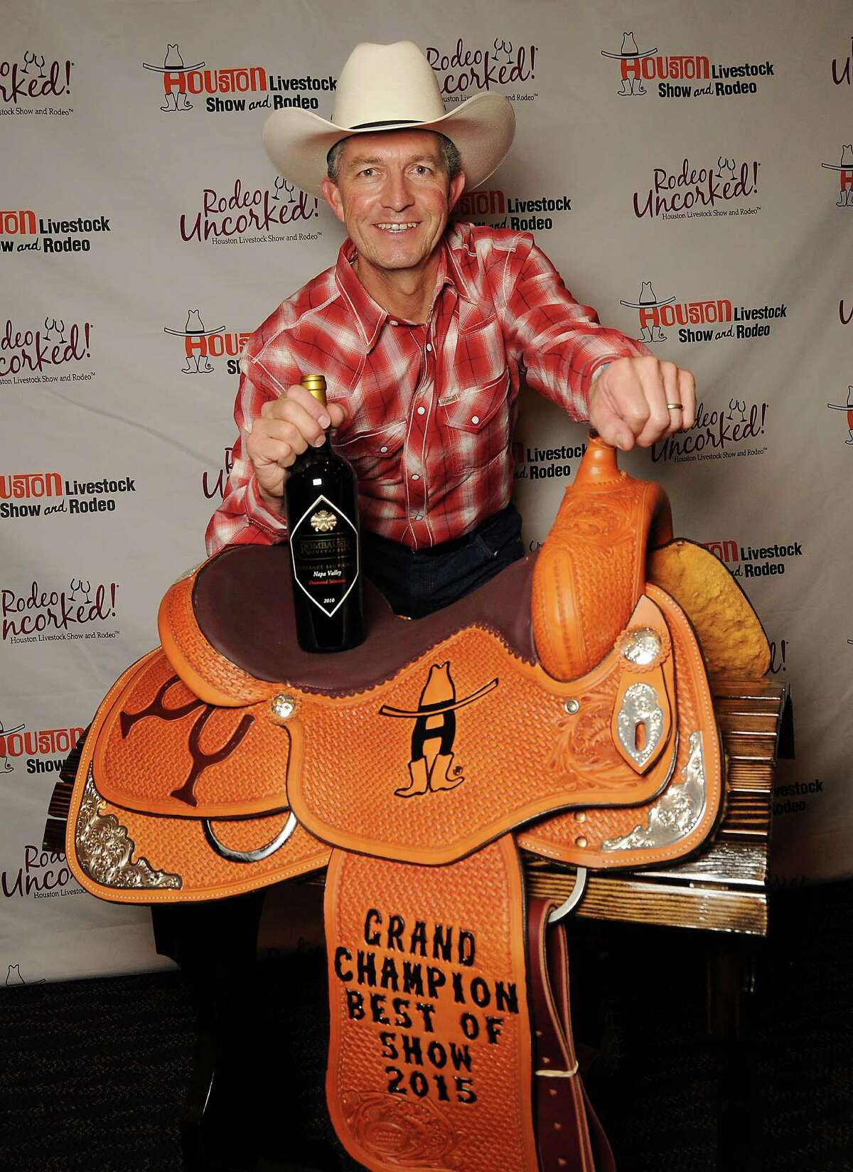 Winners of the International Wine Competition, like Grand Champion Wine winner K.R. Rombauer of Rombauer Vineyards, are awarded with custom-made saddles, chaps and belt buckles.