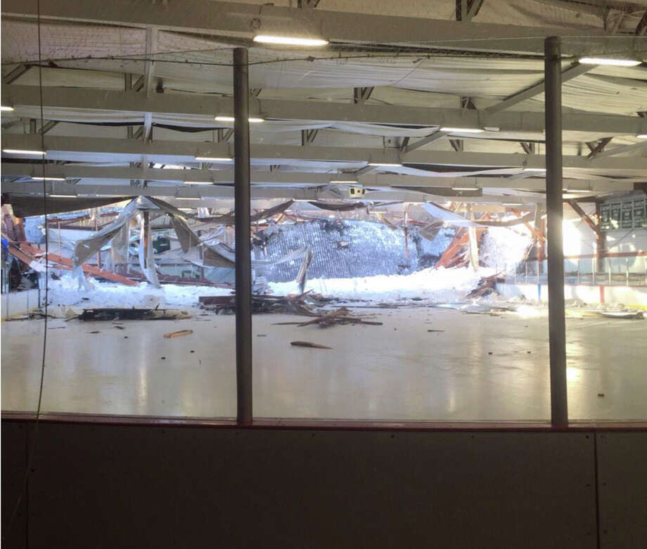 This photo provided by the Canton Police Department and taken by Chief Ken Berkowitz shows the rear portion of the roof that collapsed at the Metropolis Skating Rink on Saturday, Feb. 28, 2015 in Canton, Mass.  Canton Police  said the rear portion of the roof began to fail as a Norwood youth hockey team was inside but they were able to get out along with parents and rink workers. All are safe and accounted for. (AP Photo/Canton Police Department, Chief Ken Berkowitz)   ORG XMIT: MAPD101 Photo: Chief Ken Berkowitz / Canton Police Department