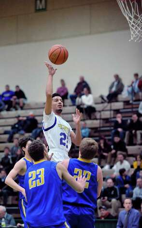Anferny Aponte of Amsterdam puts up a shot over  Queensbury players during their Class A quarterfinal game at Hudson Valley Community College on Sunday, March 1, 2015, in Troy, N.Y.     (Paul Buckowski / Times Union) Photo: PAUL BUCKOWSKI / 00030785A