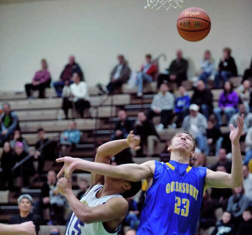 James Valentin of Amsterdam, left, and Keeghan O'Leary of Queensbury battle for a rebound during their Class A quarterfinal game at Hudson Valley Community College on Sunday, March 1, 2015, in Troy, N.Y.   (Paul Buckowski / Times Union) Photo: PAUL BUCKOWSKI / 00030785A