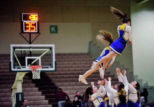 Queensbury cheerleaders perform during a timeout in their game  during their Class A quarterfinal game against Amsterdam at Hudson Valley Community College on Sunday, March 1, 2015, in Troy, N.Y.     (Paul Buckowski / Times Union) Photo: PAUL BUCKOWSKI / 00030785A