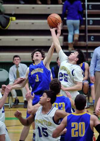 James Twyman Queensbury, left, and  Brian Stanavich of Amsterdam battle for a rebound during their Class A quarterfinal game at Hudson Valley Community College on Sunday, March 1, 2015, in Troy, N.Y.    (Paul Buckowski / Times Union) Photo: PAUL BUCKOWSKI / 00030785A