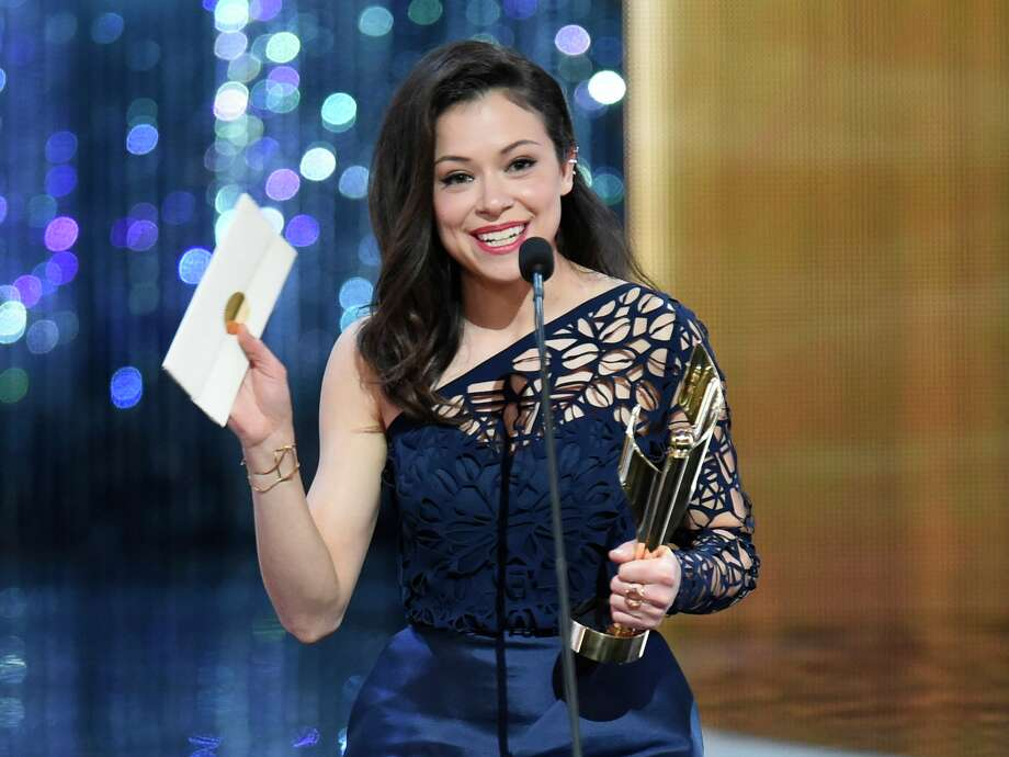 "Tatiana Maslany holds her award for best actress in a drama at the Canadian Screen Awards in Toronto on Sunday, March 1, 2015. Maslany won for her role in ""Orphan Black."" (AP Photo/The Canadian Press,Frank Gunn) ORG XMIT: FNG517 Photo: Frank Gunn / CP"