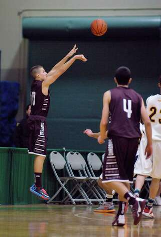 Anthony Bravo of Gloversville puts up a shot over Averill Park players during their Class A quarterfinal game at Hudson Valley Community College on Sunday, March 1, 2015, in Troy, N.Y.   (Paul Buckowski / Times Union) Photo: PAUL BUCKOWSKI / 00030786A