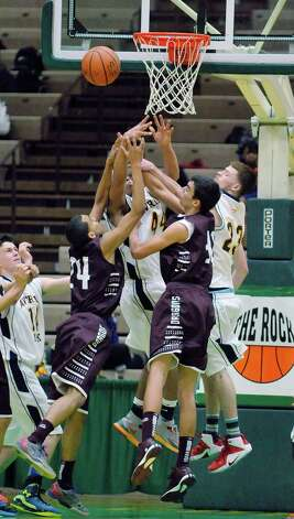 Averill Park and Gloversville players battle for a rebound during their Class A quarterfinal game at Hudson Valley Community College on Sunday, March 1, 2015, in Troy, N.Y.   (Paul Buckowski / Times Union) Photo: PAUL BUCKOWSKI / 00030786A