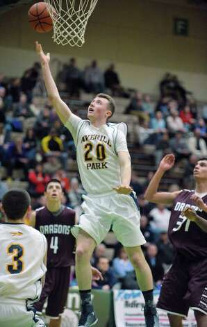 Myles Joyce of Averill Park puts up a shot past Gloversville players during their Class A quarterfinal game at Hudson Valley Community College on Sunday, March 1, 2015, in Troy, N.Y.   (Paul Buckowski / Times Union) Photo: PAUL BUCKOWSKI / 00030786A