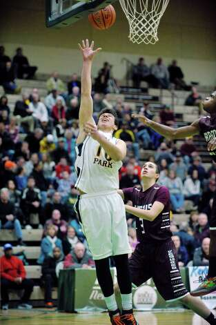 Ryan Bielawa of Averill Park puts up a shot between Gloversville players during their Class A quarterfinal game at Hudson Valley Community College on Sunday, March 1, 2015, in Troy, N.Y.   (Paul Buckowski / Times Union) Photo: PAUL BUCKOWSKI / 00030786A