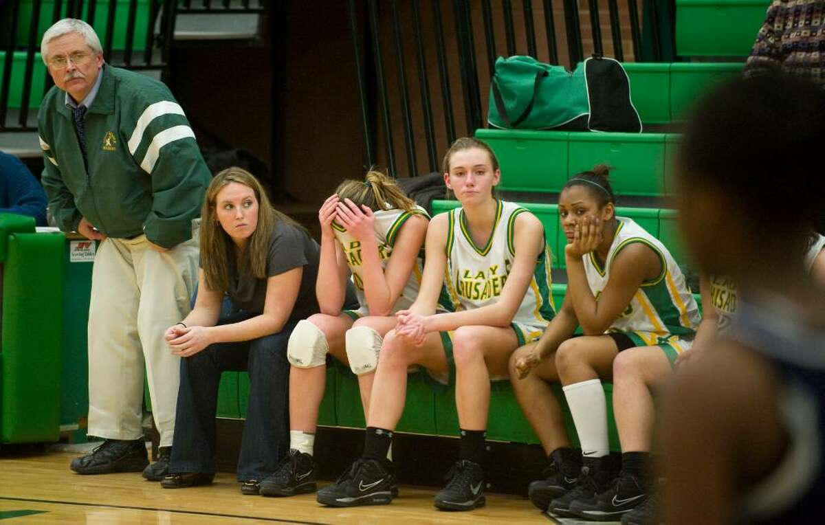 The Trinity bench watches the last seconds of their loss to Hillhouse during the second round of the girls CIAC basketball tournament at Trinity Catholic High School in Stamford, Conn. on Thursday, March 4, 2010. Trinity lost to Hillhouse 61-46.