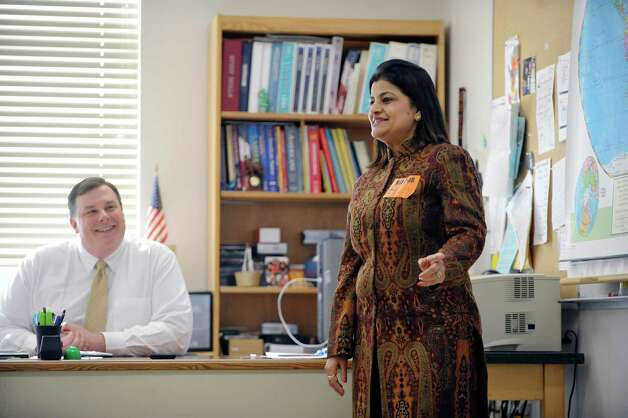 Bethlehem Middle School social studies teacher Evan Harley, left, looks on as Reena Paliwal, a teacher from India, talks about her country on Tuesday, Feb. 24, 2015, in Bethlehem, N.Y.  Paliwal is part of a group of teachers from around the globe taking part in a teaching program at the College of Saint Rose.    (Paul Buckowski / Times Union) Photo: PAUL BUCKOWSKI / 00030734A