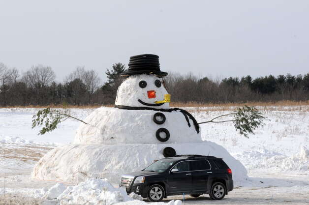 There might be more snow to add to this snowman on Monday. This giant creation graces the front of a home on route 158 Thursday Feb. 26, 2015 in Guilderland, N.Y. (Michael P. Farrell/Times Union)