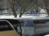 Numerous passenger buses lined the roads in Lincoln Park on Lobby Day, March 4, 2014 in Albany.  This year's Lobby Day could feature a coating of freezing rain and sleet that could make downtown travel more difficult.  (Skip Dickstein / Times Union) ORG XMIT: MER2014030415524543