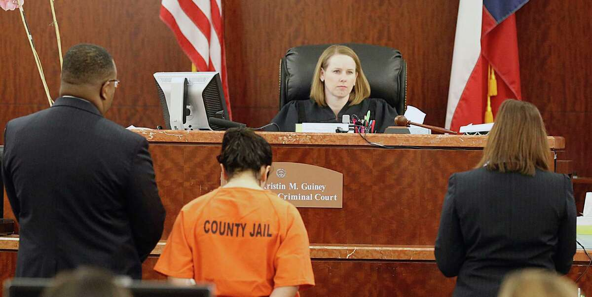 Jenea Mungia center, stands in the 179th State District Court during a hearing with her court appointed attorney Eric Davis left, as Harris County Prosecutor Kathy Kahle right, speaks with Judge Kristen Guiney 2nd from right, Mungia was arrested and charged with injury to a child, Monday March 2, 2015, in Houston. On Thursday Harris County Sheriff's deputies found Mungia allegedly beating and stabbing her 4-year-old son.