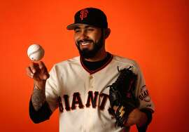Pitcher Sergio Romo #54 of the San Francisco Giants poses for a portrait during spring training photo day at Scottsdale Stadium on February 27, 2015 in Scottsdale, Arizona.