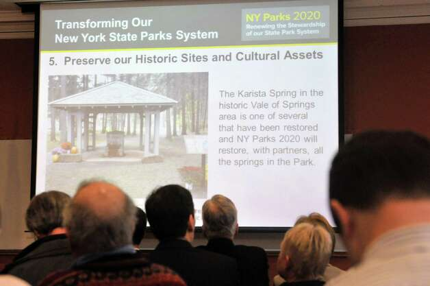 Attendees watch a presentation by New York State Parks Commissioner Rose Harvey as she unveils the $900 million NY Parks 2020 plan during a press conference at Saratoga Spa State Park on Monday, March 2, 2015, in Saratoga Springs, N.Y.  Spa State Park will see improvements through funding in the plan.  (Paul Buckowski / Times Union) Photo: PAUL BUCKOWSKI / 00030803A