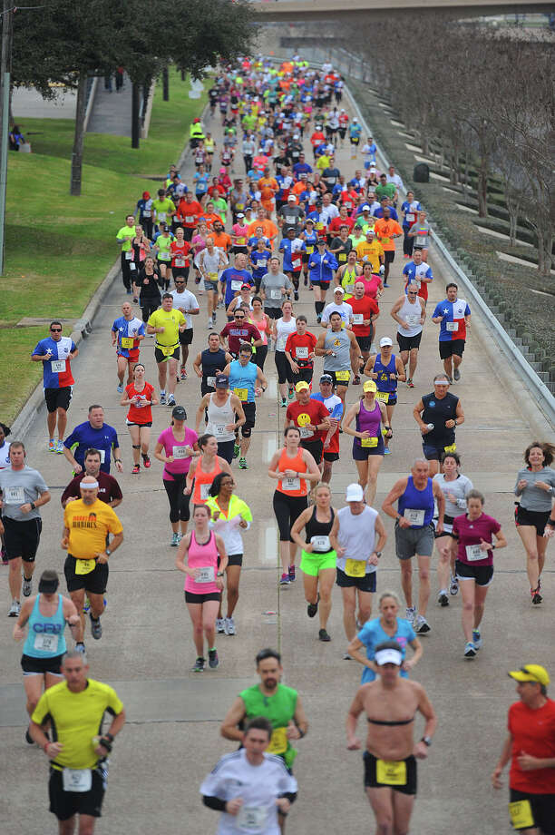 Racers run in front of Lamar University during the Gusher Marathon on Saturday. 