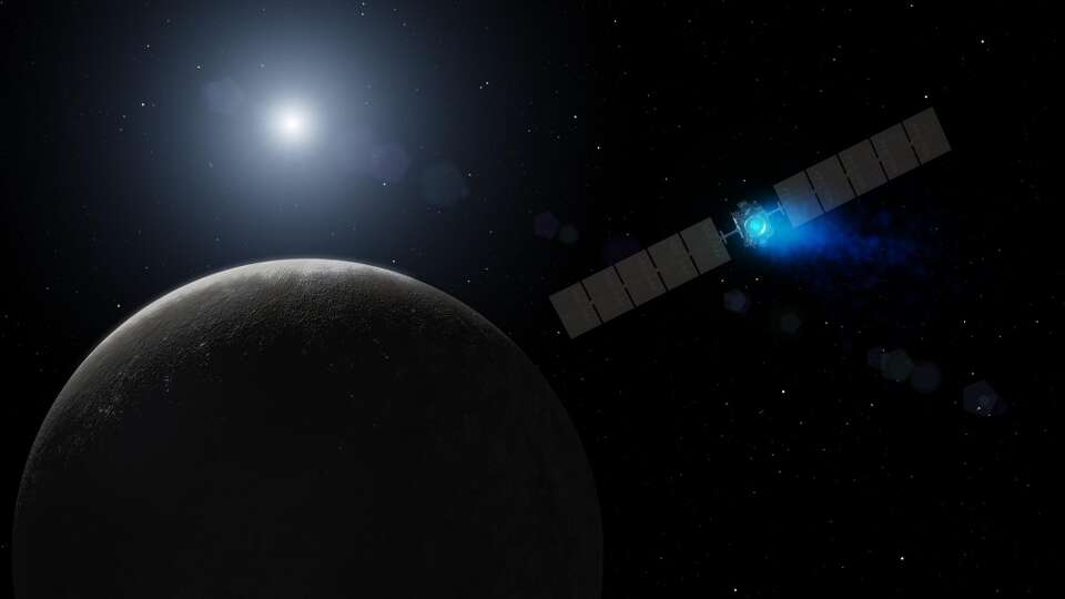 This artist's concept shows NASA's Dawn spacecraft arriving at the dwarf planet Ceres, the most mass