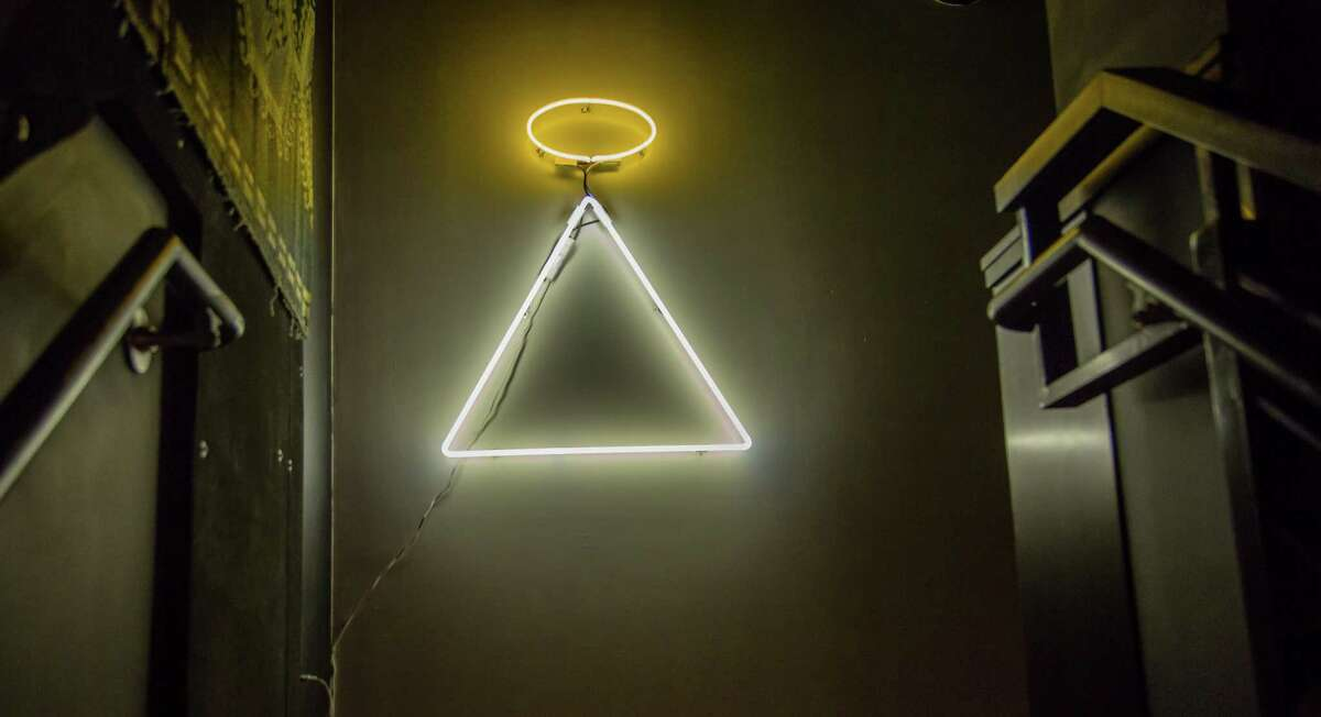 The neon at the top of the stairs at Holy Mountain in San Francisco, Calif., is seen on Saturday, February 28th, 2015.