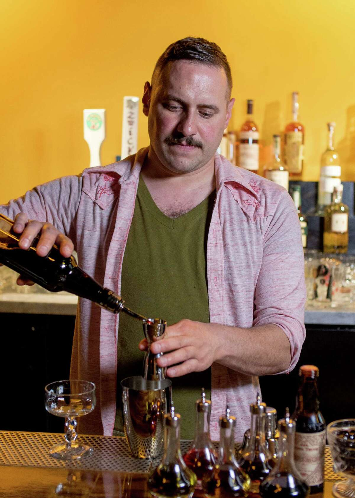 Christ Aivaliotis makes the Trinidad Sour cocktail at Holy Mountain in San Francisco, Calif., on Saturday, February 28th, 2015.