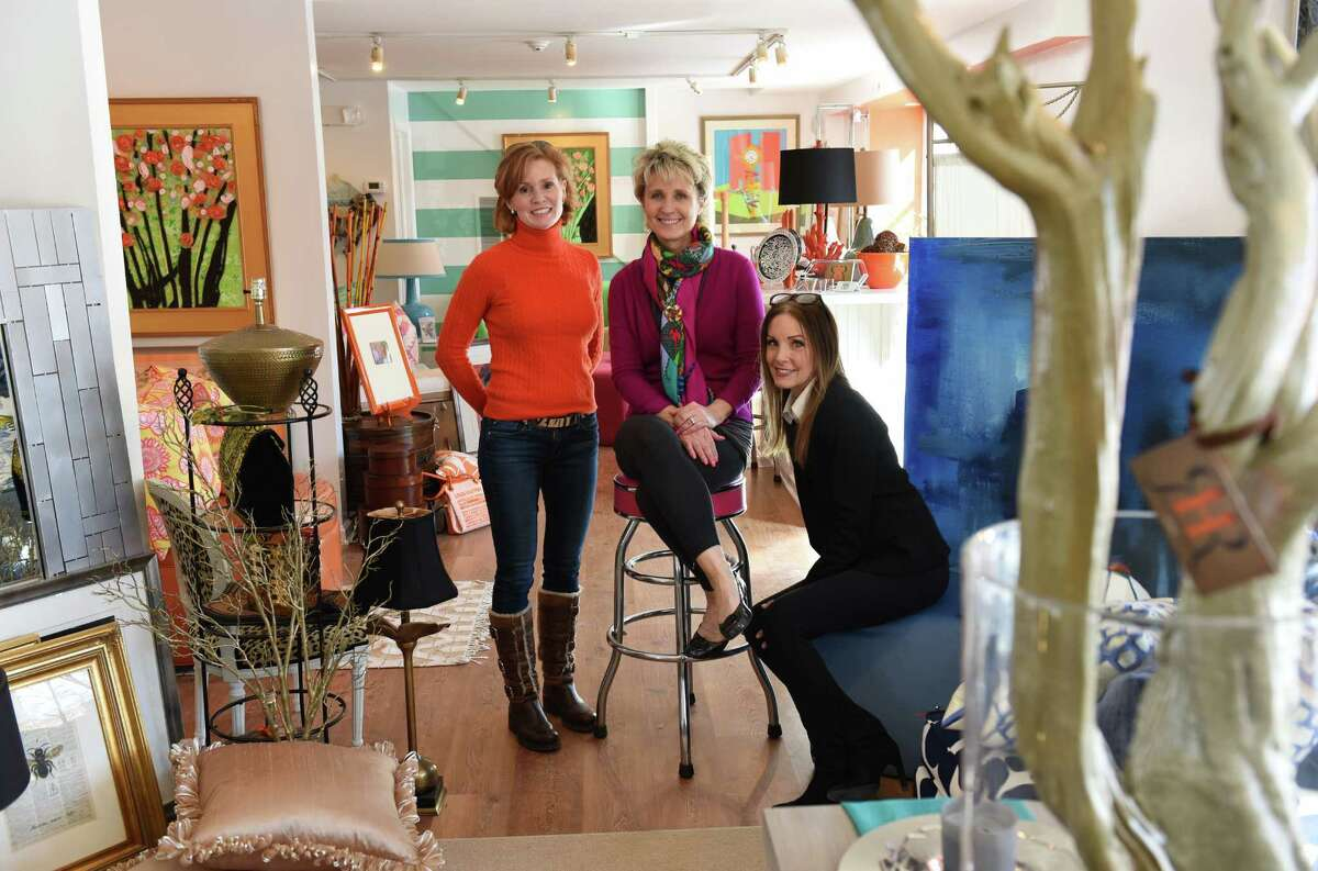 Owner Ellen Robben-Atkinson, center, sits with employees Sheilah Robben, left, and Leslie Itoh inside Round Robben Home in Greenwich, Conn. Monday, March 2, 2015. The upscale resale furnishings store opened about a month ago and will hold its grand opening on Wednesday, March 4.