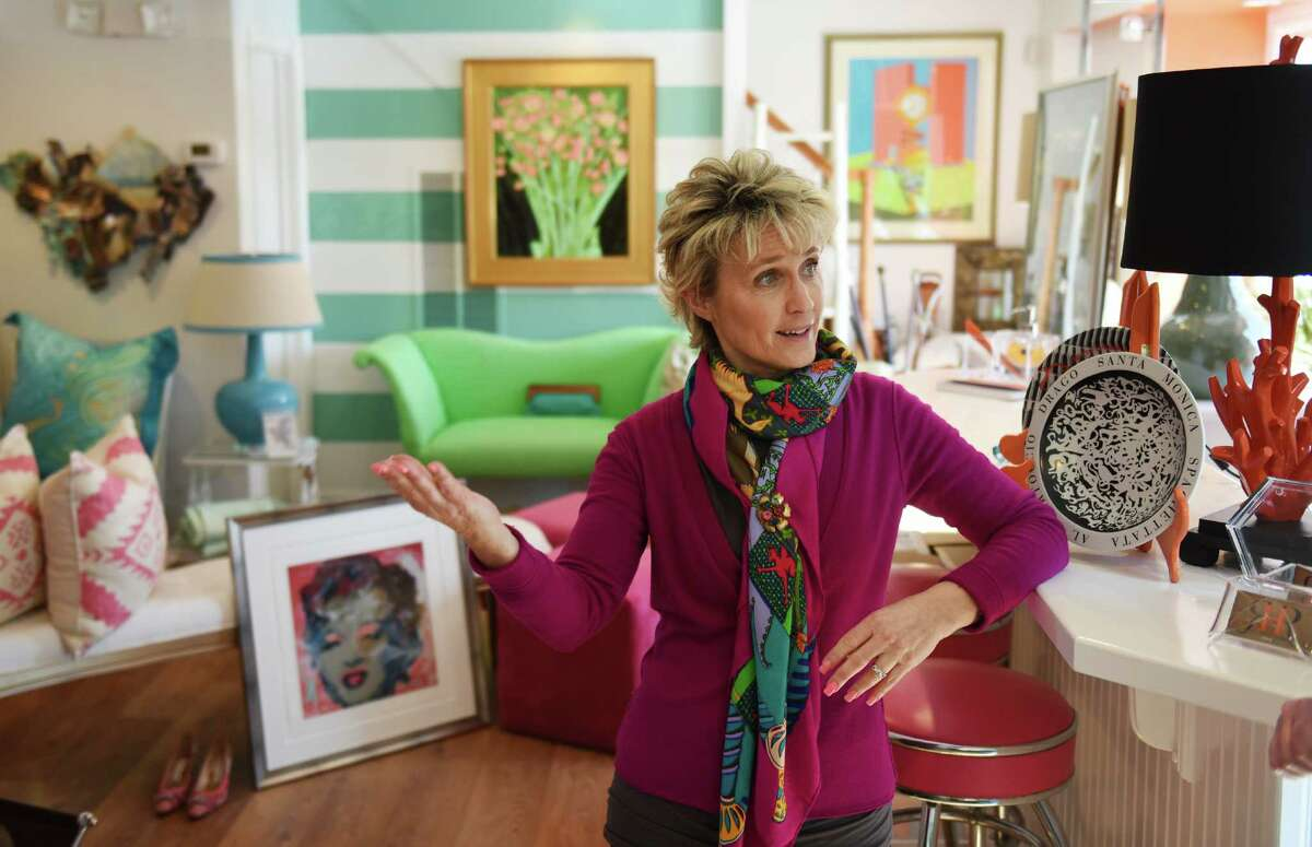 Owner Ellen Robben-Atkinson shows the variety of colorful items for sale at Round Robben Home in Greenwich, Conn. Monday, March 2, 2015. The upscale resale furnishings store opened about a month ago and will hold its grand opening on Wednesday, March 4.