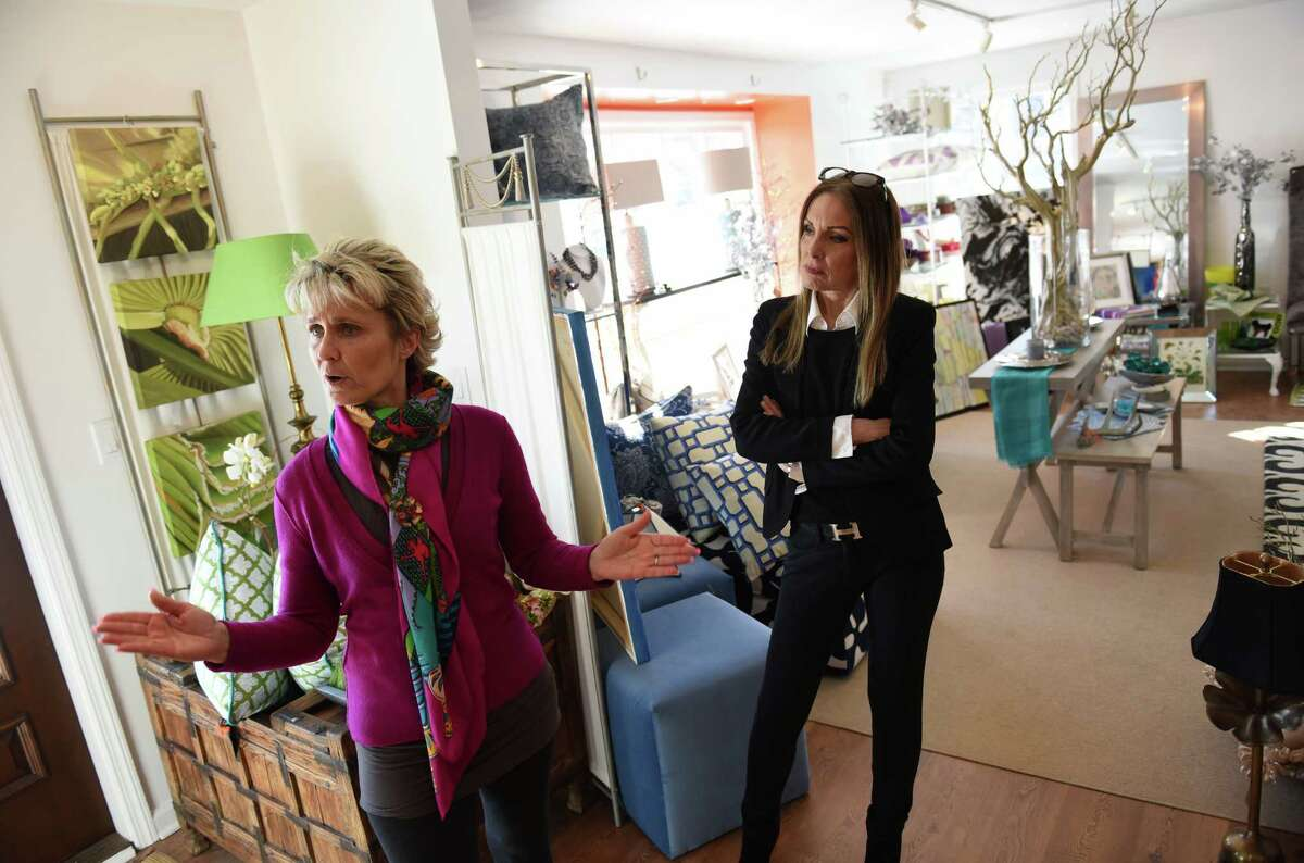 Owner Ellen Robben-Atkinson, left, and artist and employee Leslie Itoh show the variety of items for sale at Round Robben Home in Greenwich, Conn. Monday, March 2, 2015. The upscale resale furnishings store opened about a month ago and will hold its grand opening on Wednesday, March 4.