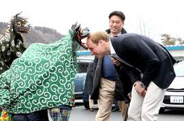 Prince William, Duke of Cambridge is greeted by Lion Dancers performing in an Shishimai Ceremony at Chime of Hope Shopping Centre on March 1, 2015 in Ishinomaki, Japan. The Duke of Cambridge is on his final day in Japan and will begin an Official visit to China tommorow.