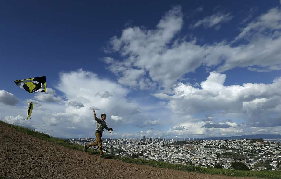 FILE - Ted Nace flies a kite atop Bernal Heights Hill in San Francisco, Saturday, Feb. 28, 2015. Photo: Jeff Chiu, Associated Press