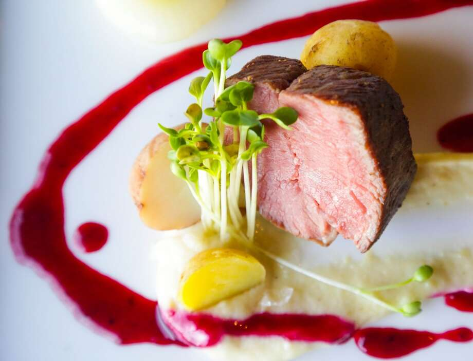 Lamb strip loin with fingerling potatoes, cipollini onions and a charred blackberry emulsion at Cullen's, 11500 Space Center Blvd. Photo: Billy Smith II, Houston Chronicle