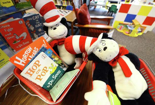 Dr. Seuss books are assembled in baskets for children to read Monday afternoon, March 2, 2015, at William K. Sanford Town Library in Colonie, N.Y. To mark Read across America Day, the Town Library held special Dr. Seuss birthday activities. They offered games and prizes, with a therapy session dog held from 4 till 5 p.m. The National Education Association sponsors the day each year. Theodor Seuss Geisel -- Dr. Seuss -- was born March 2, 1904. He published 46 children's books, often characterized by imaginative characters and rhymes. (Will Waldron/Times Union) Photo: WW / 00030823A