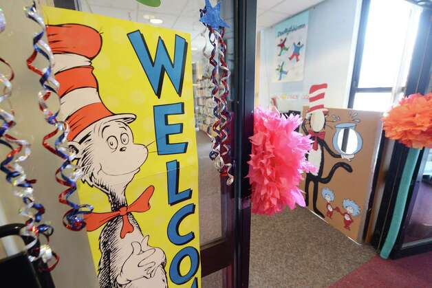 To mark Read across America Day, the William K. Sanford Town Library held special Dr. Seuss birthday activities Monday afternoon, March 2, 2015, in Colonie, N.Y.  They offered games and prizes, with a therapy session dog held from 4 till 5 p.m. The National Education Association sponsors the day each year. Theodor Seuss Geisel -- Dr. Seuss -- was born March 2, 1904. He published 46 children's books, often characterized by imaginative characters and rhymes. (Will Waldron/Times Union) Photo: WW / 00030823A