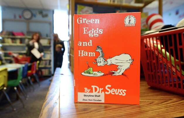 "A copy of ""Green Eggs and Ham"" is displayed Monday afternoon, March 2, 2015, at William K. Sanford Town Library in Colonie, N.Y. To mark Read across America Day, the Town Library held special Dr. Seuss birthday activities. They offered games and prizes, with a therapy dog session held from 4 till 5 p.m. The National Education Association sponsors the day each year. Theodor Seuss Geisel -- Dr. Seuss -- was born March 2, 1904. He published 46 children's books, often characterized by imaginative characters and rhymes. (Will Waldron/Times Union) Photo: WW / 00030823A"