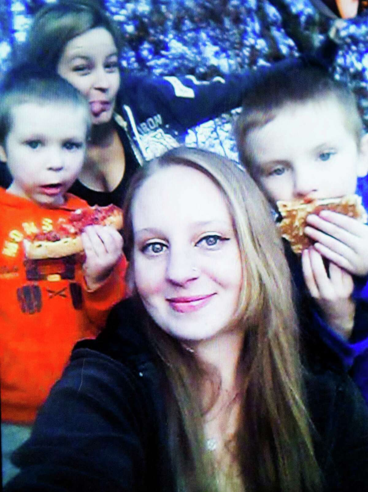 Photograph of Hayden, 6, right, and Ethan, 5, left, with their mother, center. Hayden was shot by his brother, Monday, March 2, 2015, in North East Harris County.