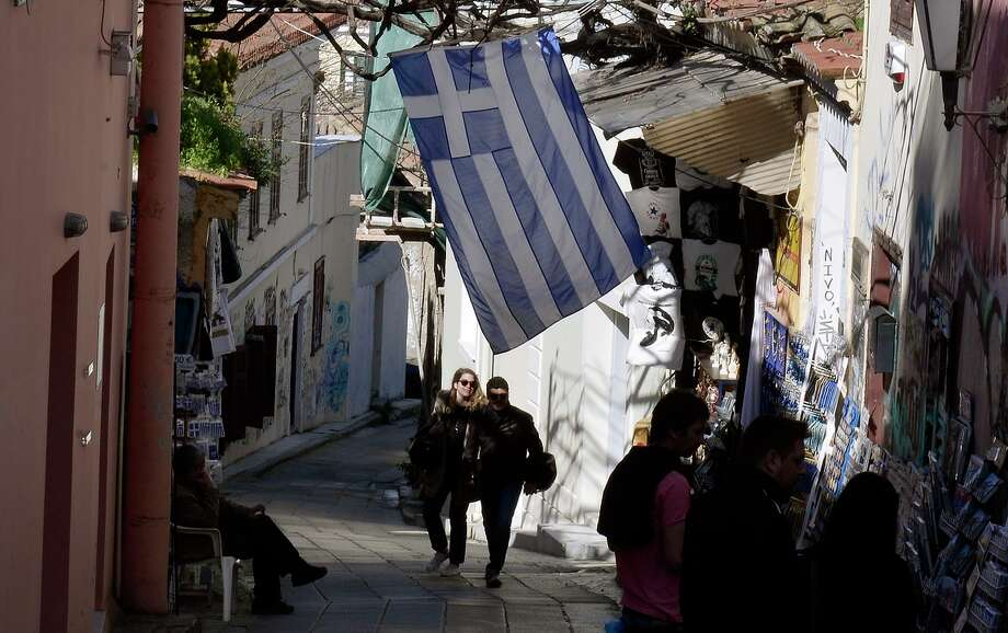 This calm scene in the Plaka neighborhood of Athens contrasts with the tumult roiling the halls of power in Europe over Greece's financial conditions and their potential impact on the eurozone ecomomy. Photo: LOUISA GOULIAMAKI / AFP / Getty Images / AFP