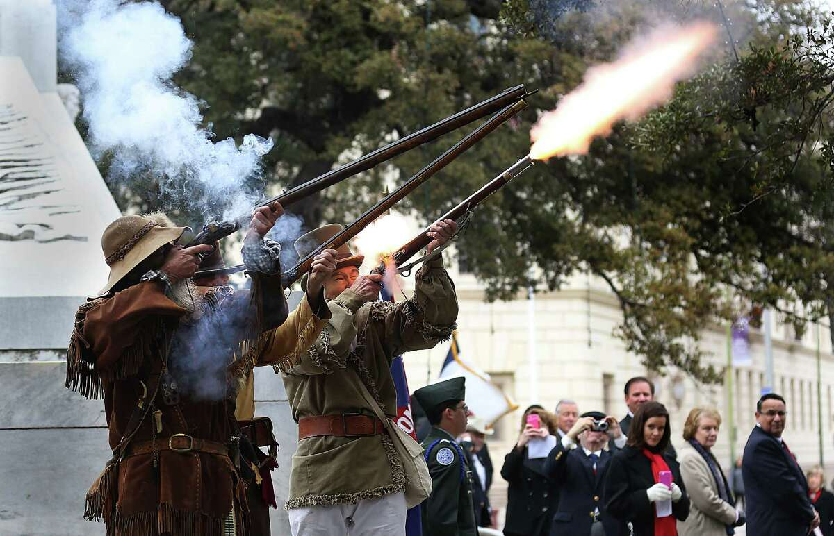 Members of the San Antonio LIving History Association fire a volley during the Daughters of the Republic of Texas Alamo Mission Chapter's Texas Independence Day Ceremony honoring Central Catholic High School. Monday, March 2, 2015.