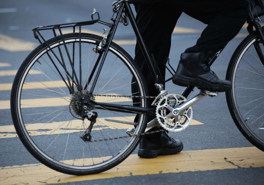 The city is considering adding bike lakes along most of Polk Street as cyclists have become more prominent and vocal.<252> Photo: Sophia Germer / The Chronicle / ONLINE_YES