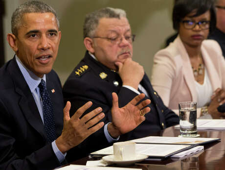 President Obama (left) received recommendations at the White House from the Task Force on 21st Century Policing.