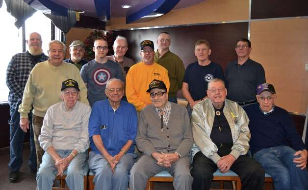 "TGIV (Thank God Its Veterans) group met at Gateway Diner Friday, as they do every Friday from 8 a.m. to noon. The diner and Patriot Flight last month also dedicated the back room as the Veterans Room. There may be videos, article and handouts that interest the ""breakfasters."" The Flag of Patriot Flight will be displayed at the diner. Gathering here are veterans of World War II, the Battle of the Bulge, Normandy Invasion, Guadalcanal, Korean War, Vietnam and an active soldier. (Lois Dysard)"