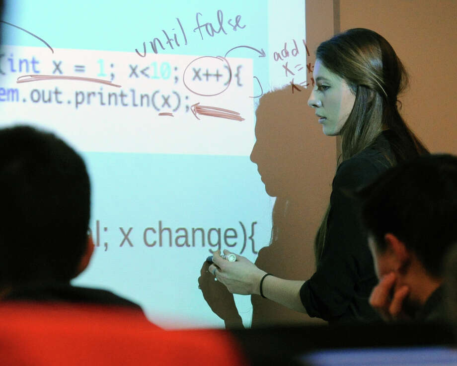 Francesca Narea, a Greenwich Academy junior, teaches Java, a basic computer programming language, to other students at Greenwich Library, Saturday, Jan. 31, 2015. Photo: Bob Luckey / Greenwich Time