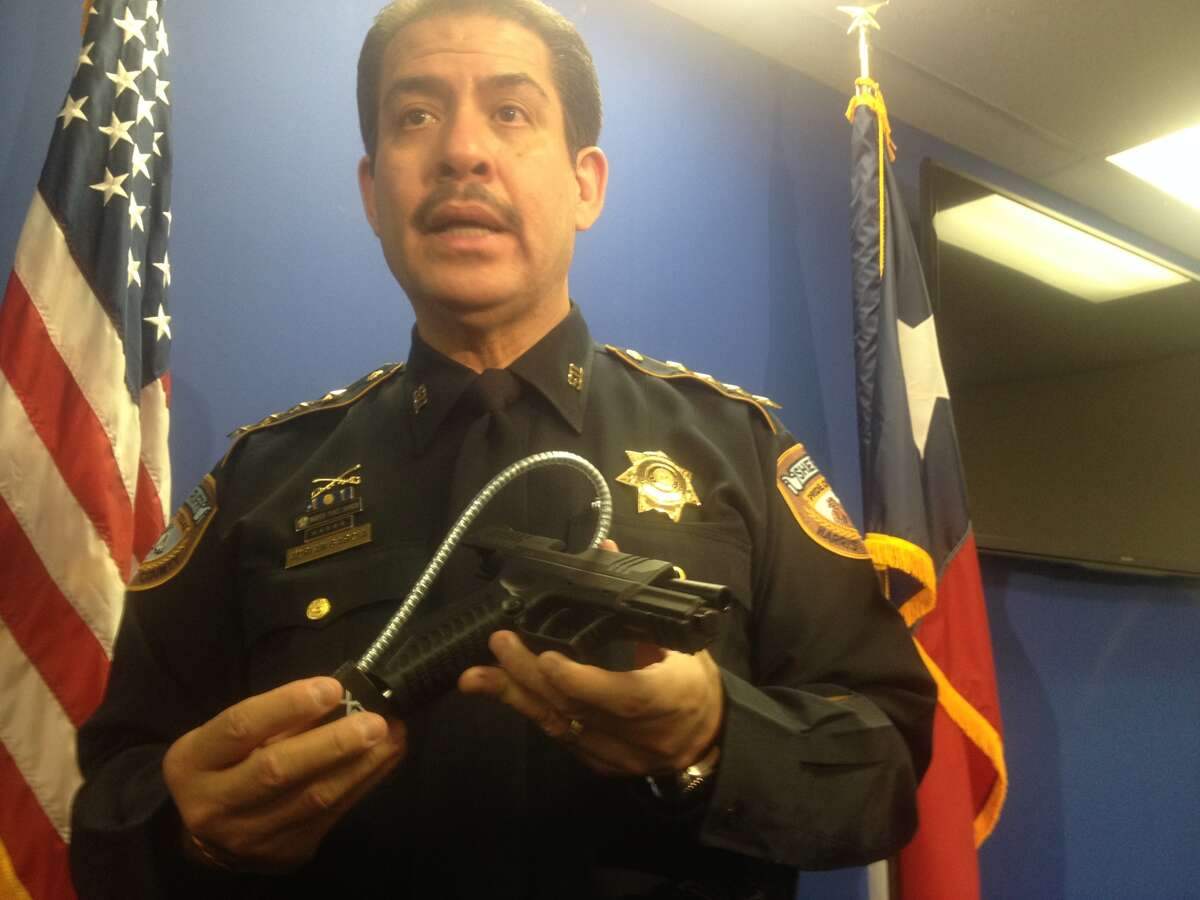 Harris County Sheriff Adrian Garcia sows an example of the gun locks that are available for free from sheriff's department storefront locations.