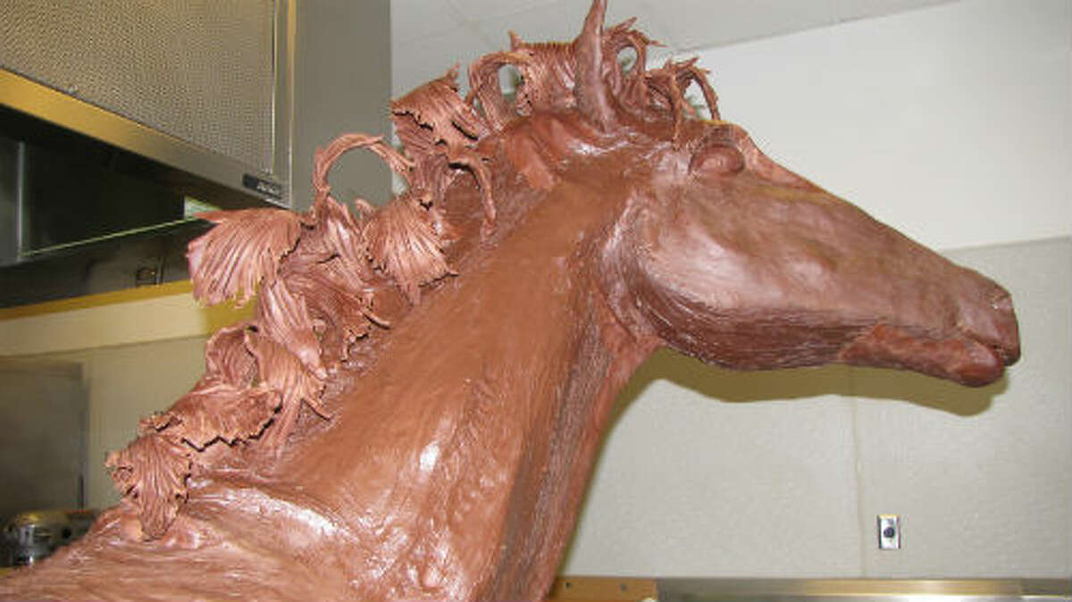 The Hilton Americas hotel in Downtown Houston is once again getting to the RodeoHouston spirit by unveiling a Wild West scene made entirely chocolate. A 350-pound horse made of chocolate is currently being installed in the lobby of the hotel, just a hop and skip from the George R. Brown Convention Center. The horse joins a chocolate cowgirl and cowboy, sculpted in past years. The pastry chef at the Hilton, Chef Mahesh Weerasinghe, also creates a large holiday scene made of chocolate every December.