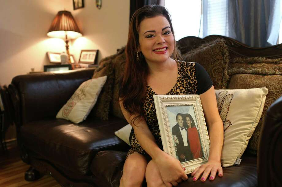 Ursula Garza Hernandez, 36, holds a portrait of her grandparents at her Northwest Side apartment Sunday. Hernandez is an insulin-dependent diabetic and her grandparents died of diabetic complications. The single mom previously was unable to afford her medication, sometimes relying on donated samples of insulin from her doctor, but she qualified for a tax credit that enabled her to buy medical insurance through the federal marketplace this year. Photo: Jerry Lara /San Antonio Express-News / © 2015 San Antonio Express-News
