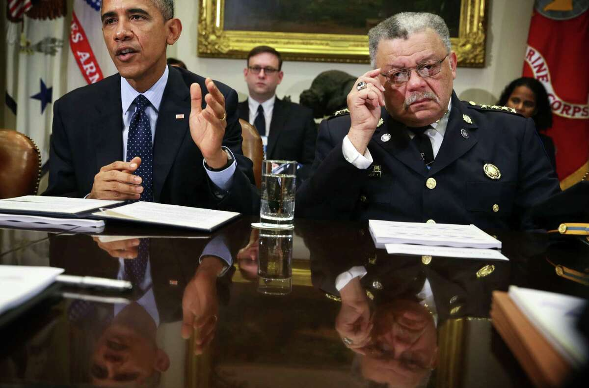 President Barack Obama, shown with Philadelphia police commissioner Charles Ramsey, spoke of changes needed for police after the deaths of black men in Missouri and New York. (R) listens during a meeting to receive his Task Force on 21st Century Policing's interim report in the Roosevelt Room of the White House March 2, 2015 in Washington, DC. President Obama met with the task force