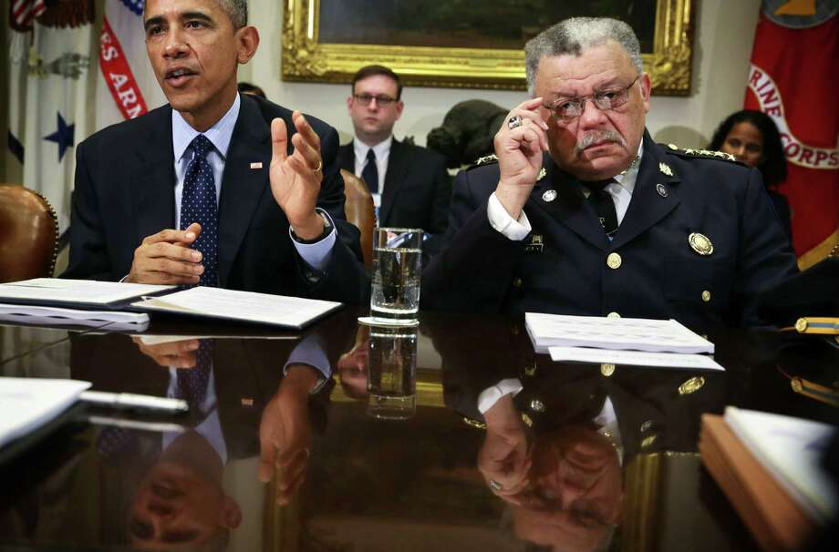 "President Barack Obama, shown with Philadelphia police commissioner Charles Ramsey, spoke of changes needed for police after the deaths of black men in Missouri and New York.  (R) listens during a meeting to receive his Task Force on 21st Century Policing's interim report in the Roosevelt Room of the White House March 2, 2015 in Washington, DC. President Obama met with the task force ""to discuss their recommendations on how to strengthen community policing and strengthen trust among law enforcement officers and the communities they serve."" (Photo by Alex Wong/Getty Images) *** BESTPIX *** Photo: Alex Wong /Getty Images / 2015 Getty Images"