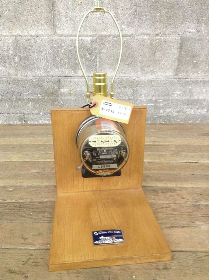 """Seattle City Light Lamp ... Stained oak base, vintage electricity meter housing for the electrical bits and a shiny 'Seattle City Light' badge. Has harp for a shade but does not come with one. Definitely a conversation piece."" Price: $95. Photo: Second Use"
