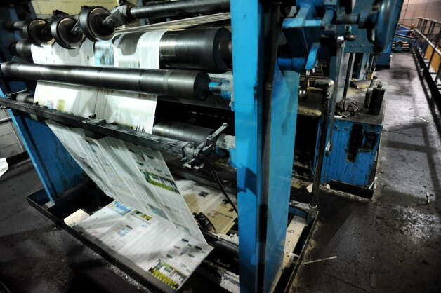 The Goss offset press churns out The Kingston Daily Freeman on Thursday, Aug. 15, 2013, at The Troy Record in Troy, N.Y. (Cindy Schultz / Times Union) Photo: Cindy Schultz / 00023553A