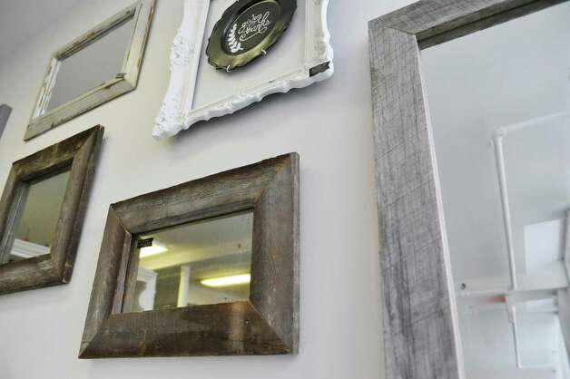 A view of some mirrors for sale at FunCycled on Monday, March 2, 2015, in Troy, N.Y.  The owners, Sarah and John Trop recently won a $5,000 prize on an HGTV reality show.  (Paul Buckowski / Times Union) Photo: PAUL BUCKOWSKI / 00030824A